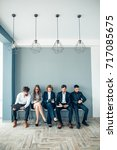 business people waiting for job ... | Shutterstock . vector #717085675