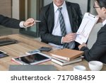 young financial consultant... | Shutterstock . vector #717088459