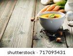 vegetable cream soup in bowl... | Shutterstock . vector #717095431