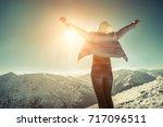 happy woman relaxing on the top ... | Shutterstock . vector #717096511
