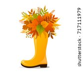 yellow rubber boot decorated... | Shutterstock .eps vector #717111979