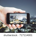 male hand taking photograph of... | Shutterstock . vector #717114001