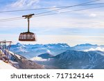 Cable Car And Snow Mountains...