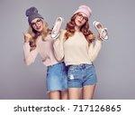 young woman having fun crazy.... | Shutterstock . vector #717126865
