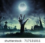 zombie hand rising out of a... | Shutterstock . vector #717131011