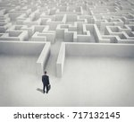 Small photo of Business challenge. A businessman navigating through a maze. Top view