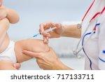 doctor makes a baby an...   Shutterstock . vector #717133711