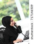 beautiful muslim lady at work | Shutterstock . vector #717146509