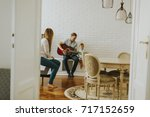 happy family with guitar at home | Shutterstock . vector #717152659