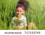 little afro american girl with... | Shutterstock . vector #717153745