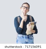 portrait of thoughtful student | Shutterstock . vector #717156091