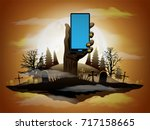 zombie hand holding smartphone... | Shutterstock .eps vector #717158665
