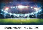 stadium in lights and flashes... | Shutterstock . vector #717163225