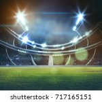 stadium in lights and flashes... | Shutterstock . vector #717165151