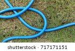 blue water tube on grass | Shutterstock . vector #717171151