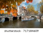 traditional old houses on canal ... | Shutterstock . vector #717184609