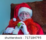 funny santa claus with green... | Shutterstock . vector #717184795