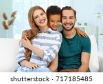 happy couple with adopted... | Shutterstock . vector #717185485