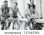 happy friends riding old style... | Shutterstock . vector #717187351