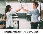happy colleagues giving five as ... | Shutterstock . vector #717192805