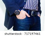 hand in pocket with wrist watch ... | Shutterstock . vector #717197461