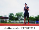 young man jogging in the... | Shutterstock . vector #717208951