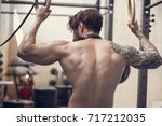 shirtless bearded man doing... | Shutterstock . vector #717212035