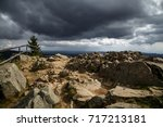 Small photo of Stones, mountains, and dark clouds sweep across the country