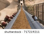 rock filtering conveyor belt at ... | Shutterstock . vector #717219211