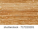 Water Drops On A Brown Wooden...