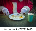 breakfast of santa claus with... | Shutterstock . vector #717224485