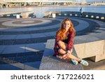 beautiful laughing young girl.... | Shutterstock . vector #717226021