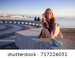 beautiful laughing young girl... | Shutterstock . vector #717226051
