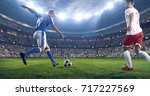 soccer player kicks the ball on ...   Shutterstock . vector #717227569