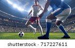 soccer player kicks the ball on ... | Shutterstock . vector #717227611