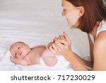 mother and newborn baby. baby... | Shutterstock . vector #717230029