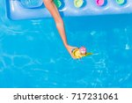 relaxing in a swimming pool on... | Shutterstock . vector #717231061