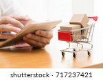 hand men using the tablet and... | Shutterstock . vector #717237421