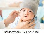 mother burp baby boy after... | Shutterstock . vector #717237451