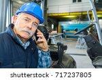 portrait of a senior man... | Shutterstock . vector #717237805