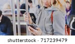 person looking at the screen of ... | Shutterstock . vector #717239479