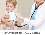 cute smiling boy at the doctor... | Shutterstock . vector #717242881