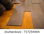 vinyl floor is laid on parquet... | Shutterstock . vector #717254404