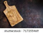 rustic wooden cutting board on... | Shutterstock . vector #717255469