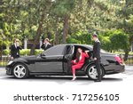 bodyguard helping young... | Shutterstock . vector #717256105