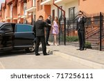 young celebrity with bodyguards ... | Shutterstock . vector #717256111