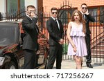 young celebrity with bodyguards ... | Shutterstock . vector #717256267