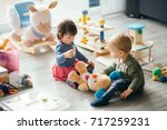 cute little girl and boy... | Shutterstock . vector #717259231