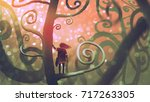 girl standing on a branch of a... | Shutterstock . vector #717263305