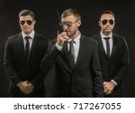 handsome bodyguards on dark... | Shutterstock . vector #717267055